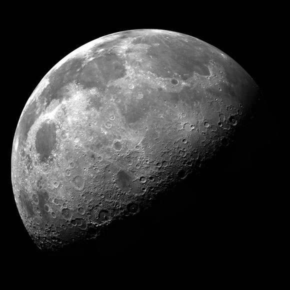 Image of the moon, half-illuminated and half in darkness.
