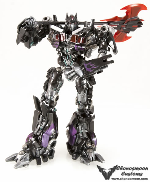 A complicated black silver and purple transformer with a large orange axe