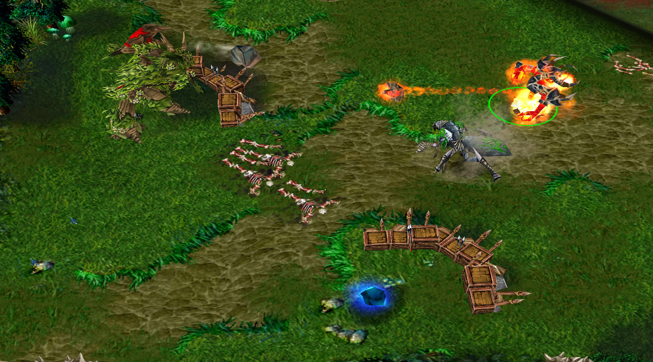 A firelord hero attacks an Elf tower, while a blue crystal floats in the vacant spot next to it where a tower previously stood