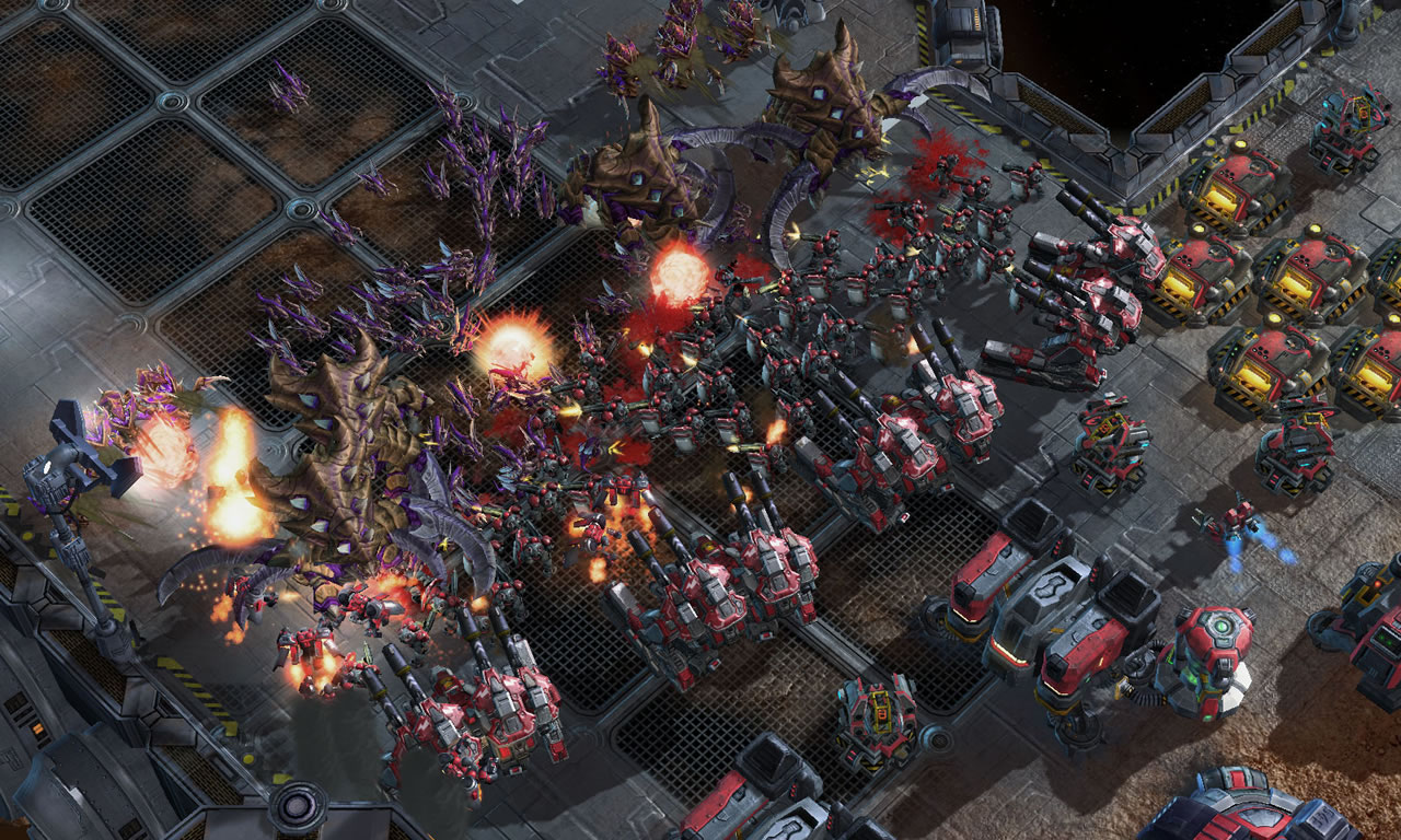 Picture of gameplay from Starcraft II featuring a large number of units engaging in combat